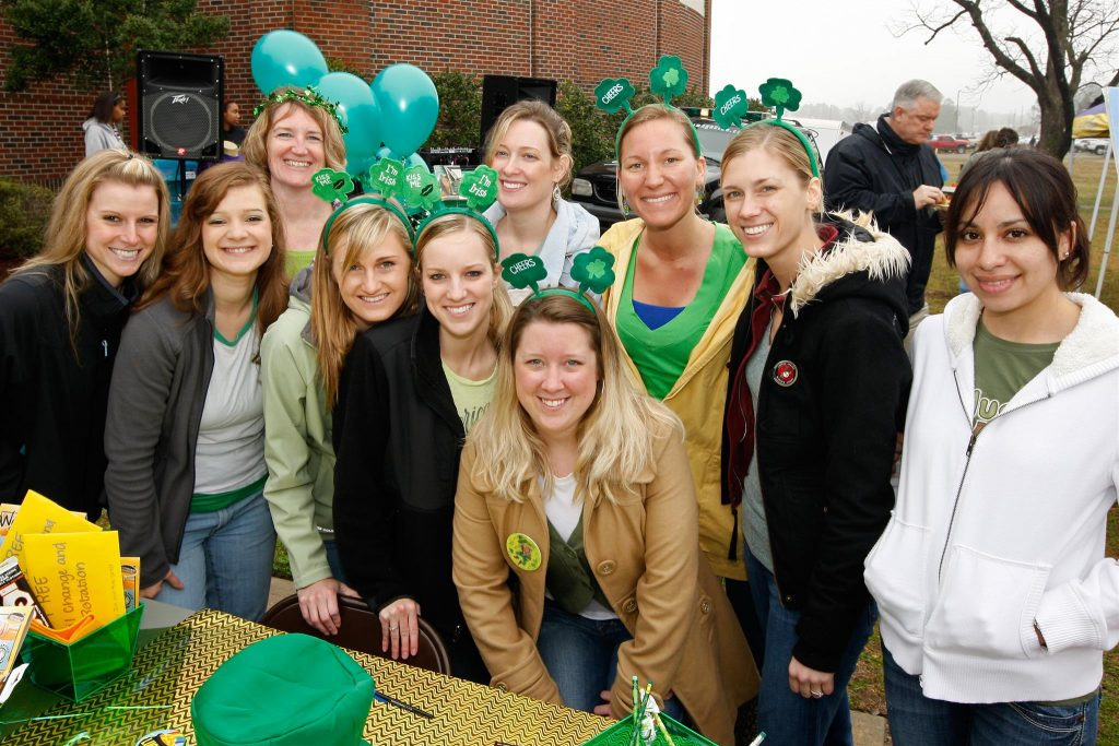 A group of female students wearing shamrock headbands