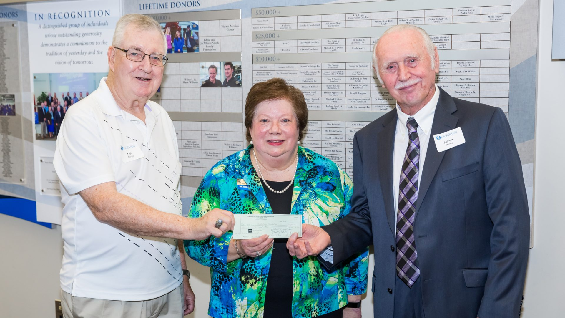 On behalf of the Kiwanis of the Golden K Foundation, Neil Dorsey (left) and Bob Hursey present a $1,000-check to PCC Vice President of Institutional Advancement Susan Nobles in support of the PCC Foundation's Ricks Automotive Scholarship.