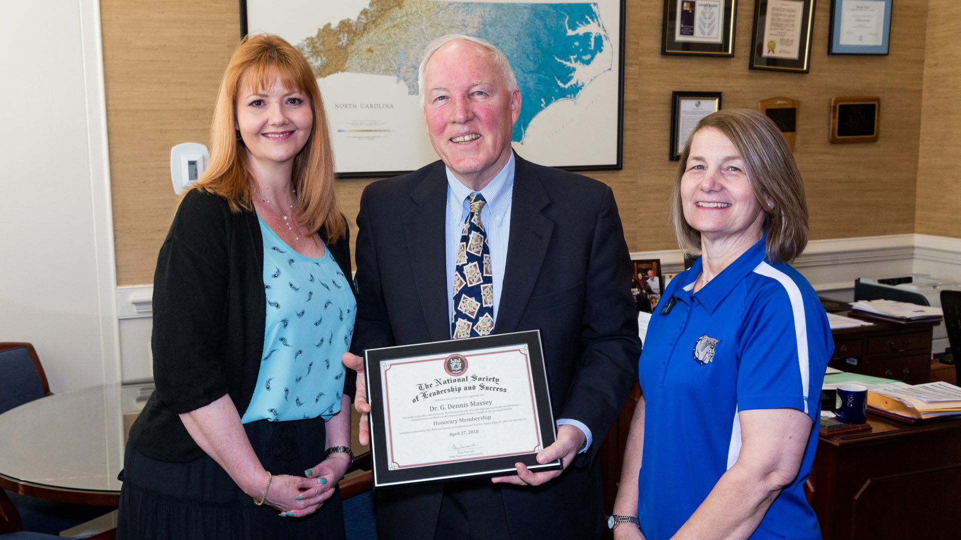 PCC's National Society of Leadership and Success chapter recently awarded honorary membership to retiring Pitt President G. Dennis Massey. Presenting the certificate were the college's NSLS advisors, Lynda Civils (left) and Faith Fagan, who was named the national leadership organization's Advisor of the Year just a week later.