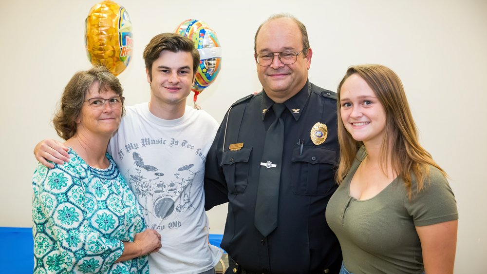 Former PCC Police Chief Jay Shingleton with members of his family at his on-campus retirement reception.