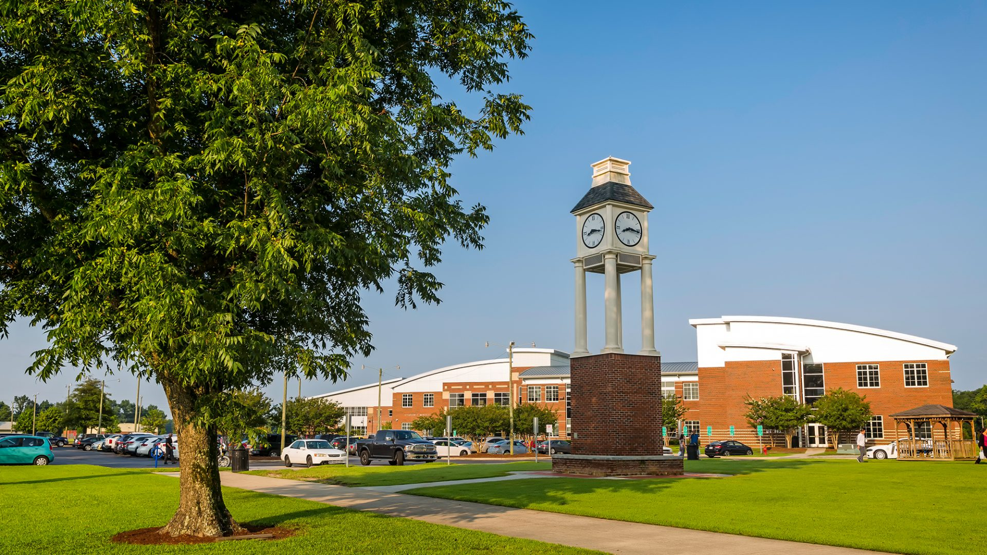Photo of PCC's Clock Tower with the Charles Russell Building in the background on a summer morning in August.