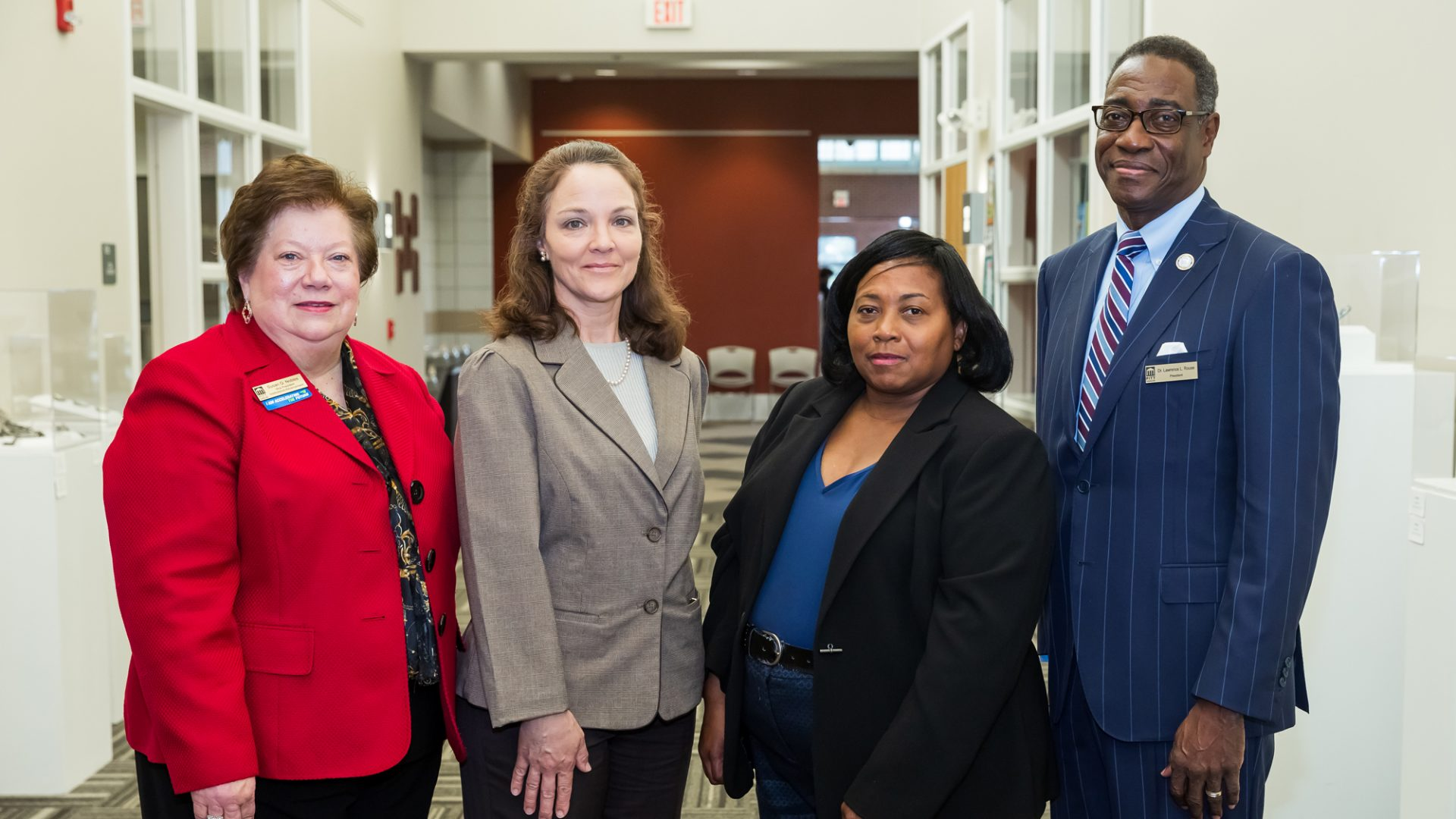 PCC graduate Dawn Fletcher (second from left) has received the William Rawlinson Scholarship. On hand for the presentation are, left to right: PCC Vice President of Institutional Advancement Susan Nobles, PCC Veterans Affairs Coordinator Sonji Rowsom and PCC President Lawrence Rouse.