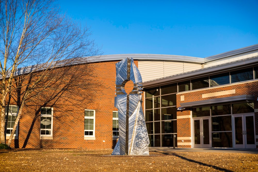 """A Moment of Discovery"" sculpture by artist Hanna Jubran outside of the Craig F. Goess Student Center."