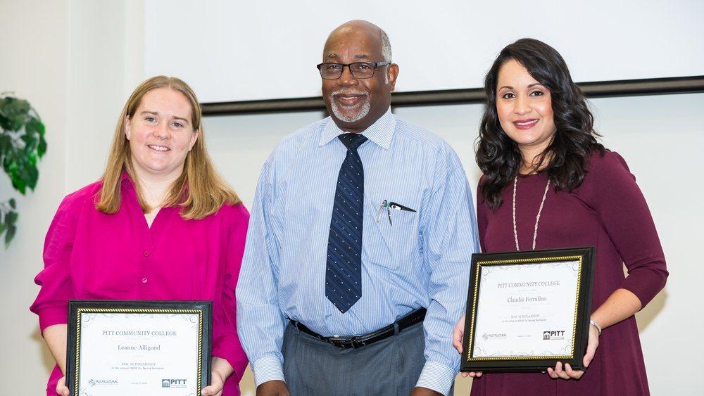 Representing the family of the late Dr. Andrew Best, William Best, center, presented scholarships to students Leanne Alligood, left, and Claudia Ferrufino during PCC's annual MLK breakfast tribute. The scholarships were given in memory of Dr. Best, a Lenoir County native who practiced medicine in Greenville from 1954 to 2004.