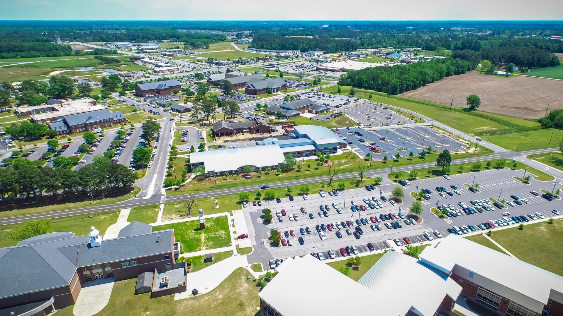 Aerial photo of PCC campus on a bright, sunny day (circa 2017).