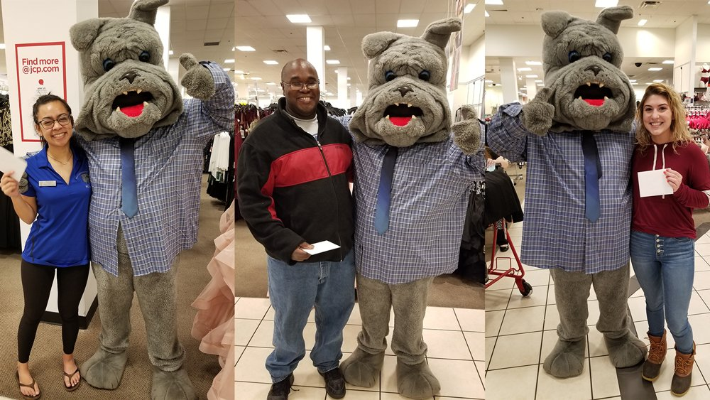 Three students who won $100-gift cards to spend at JCPenney celebrate with PCC's bulldog mascot, Bruiser.