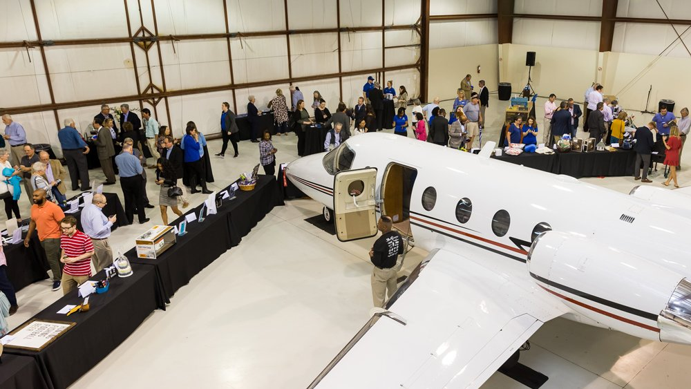 The PCC Foundation's 2019 Accelerating the Future fundraiser was held in private airplane hangars at the Pitt-Greenville Airport.