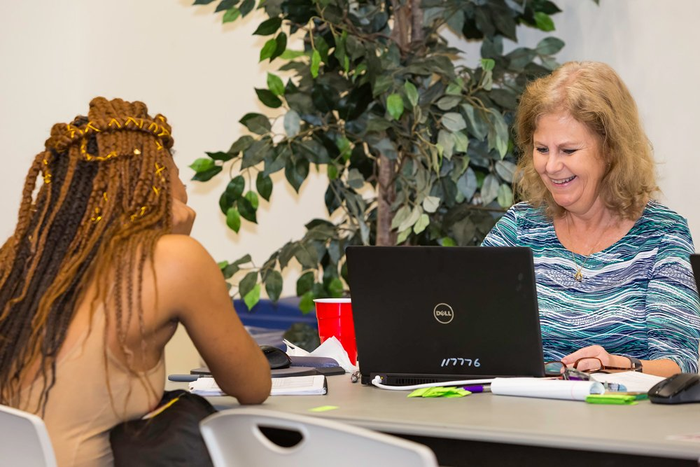 PCC Senior Success Navigator Susan Marsh, right, helps a current student plan and schedule courses for the summer and fall semesters during a special Student Education Planning Event on campus this month.