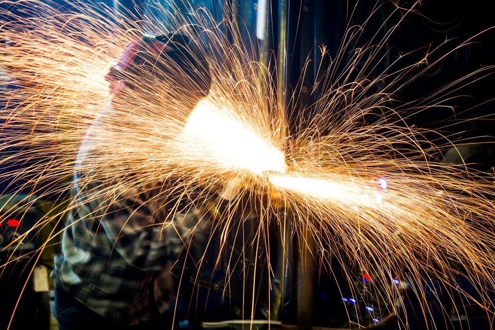 Welder surrounded by sparks.