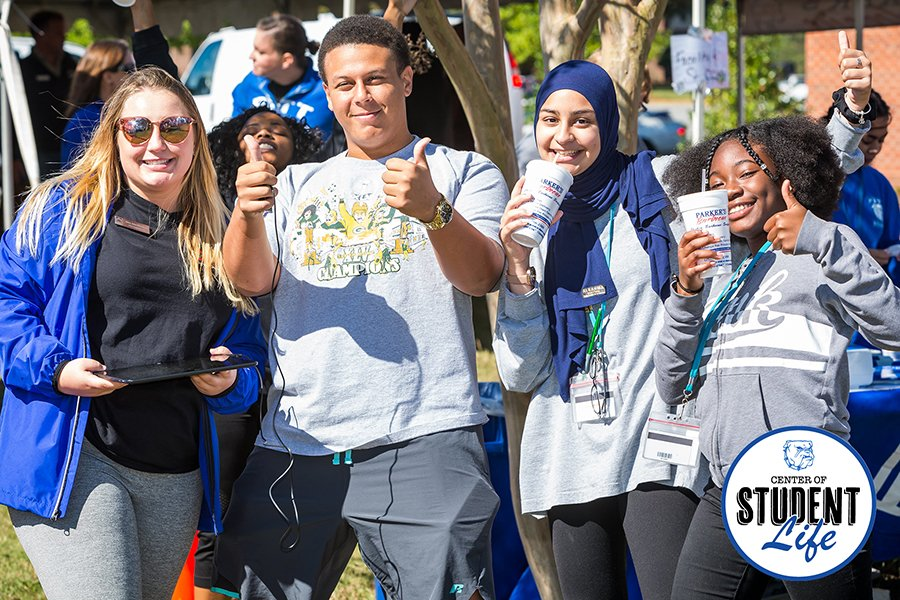 Photo of four happy students enjoying student life at Pitt Community College.