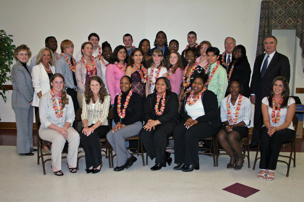 Group photo of VISIONS graduates and program organizers.