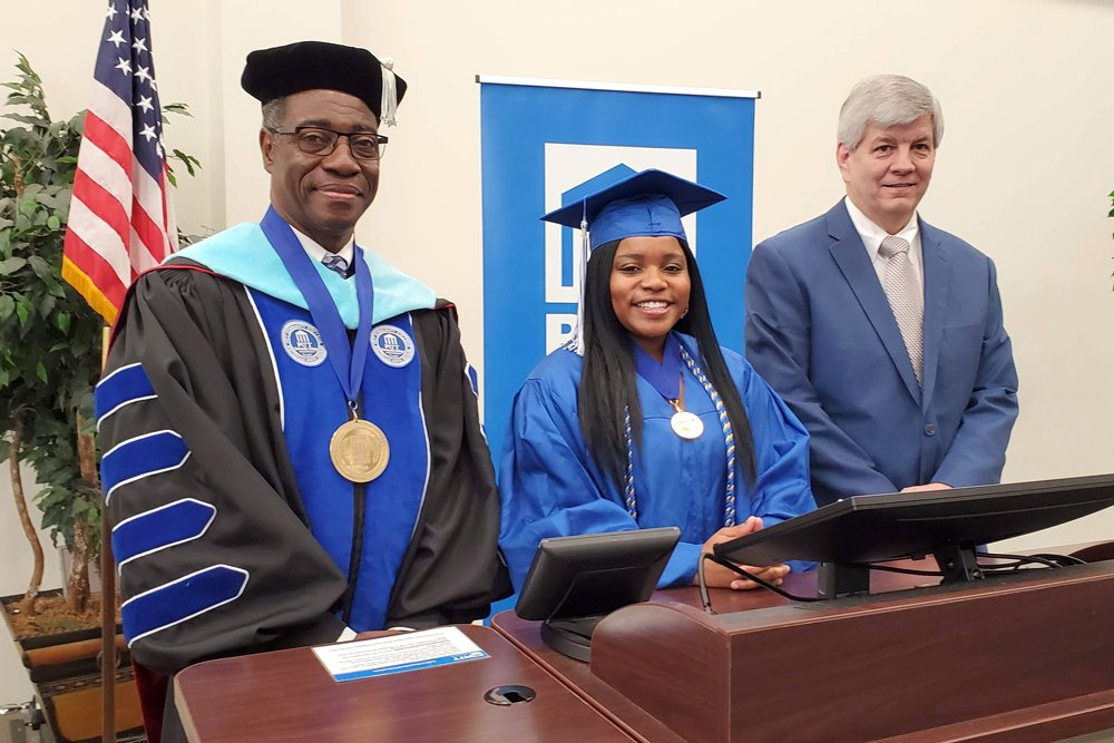 Photo of PCC President Lawrence Rouse, SGA President Curtisia Canady and Trustees Chairman Gary Evans during taping of the college's 2020 virtual graduation ceremony.