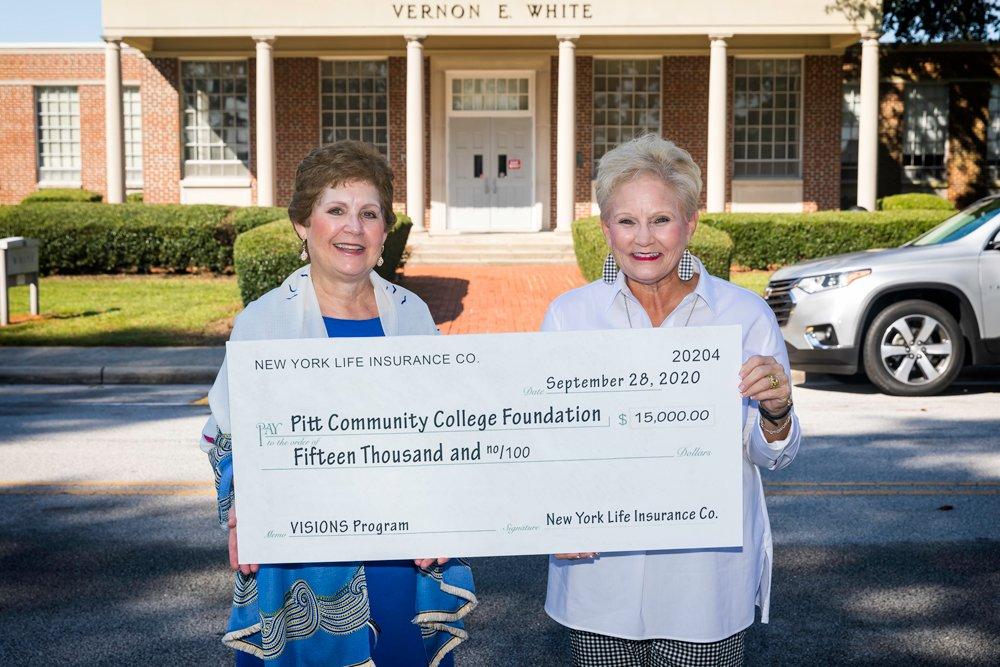 Vera Braswell presents check to PCC Foundation Executive Director Beth Sigmon.