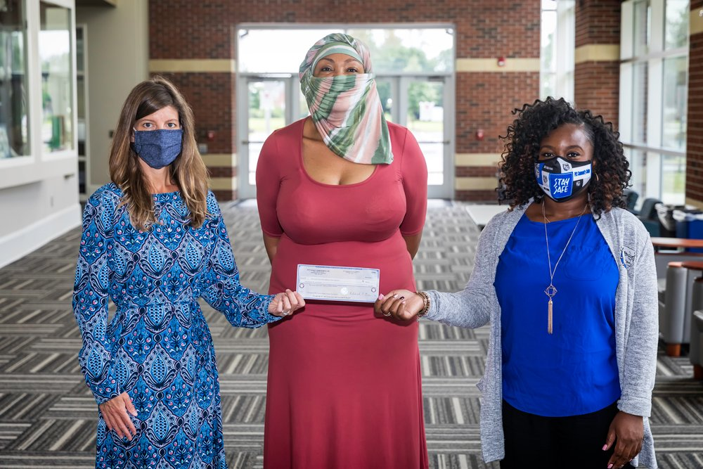 Madelyn Jones (center), chairperson of Farm Bureau's Women's Committee, presents a $250-check to PCC counselors Olivia Sutton (left) and Mecca Waller in support of the college's on-campus food pantry. The contribution came as part of a committee service project to benefit the pantry, which PCC counseling staff utilize to keep students in need from going hungry.