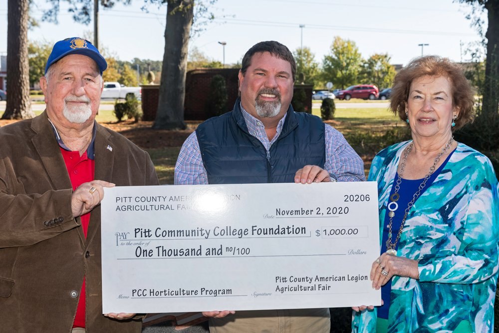 Check presentation with three people holding large check to PCC Horticulture Technology program.
