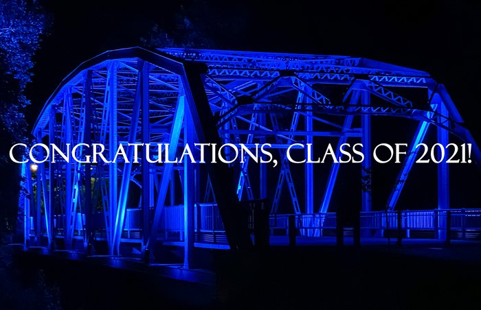 The City of Greenville turns the Greene Street Bridge PCC Blue in honor of the college's 2021 graduating class.