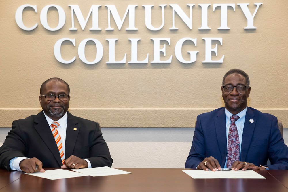 Pitt County District Attorney Faris Dixon, left, and PCC President Lawrence Rouse signed a memorandum of understanding this month, formalizing a longtime partnership intended to help lawbreakers turn their lives around through education.