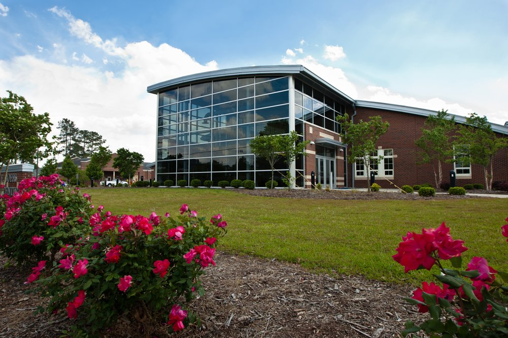 Roses bloom in front of the Craig F. Goess Student Center on PCC main campus.